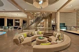 luxury sunken living room with wood flooring and high ceilings