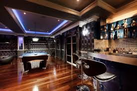 Basement ideas man cave Unfinished Basement Large Glamorous Man Cave With Coffered Ceiling Design With Builtin Neon Lighting Theres Home Stratosphere 101 Man Cave Ideas That Will Blow Your Mind photos