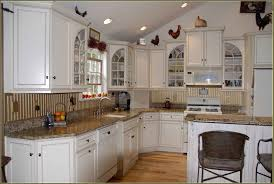 kitchen cottage interior with kitchen cabinets to ceiling also arched storage doors cottage interior with