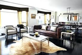 faux cowhide rug faux cowhide rug living room contemporary with animal skin apartment armchair brown leather faux cowhide rug