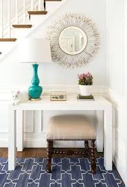 sheen madeline weinrib rugs chic foyer features a staircase wall clad in wainscoting lined with a