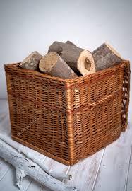 logs in wicker basket stock photo