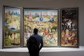 a man looks at of the garden of earthly delights triptych by the dutch