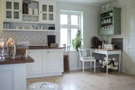 alternatively you could create a cosy look with smaller wedge shaped shelves nestling in your kitchen corners