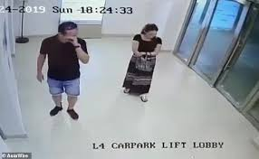 a woman ping with a male companion in singapore was left crumpled on the floor after