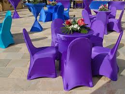 blue and purple spandex covers for round cocktail wedding table with flower centerpieces and 5 chairs ideas