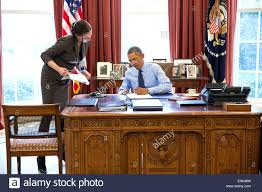 president office chair. Us President White House Website Office Chair Stock Photo Barack Obama With Staff Secretary Joani Walsh Signs Bills In The Oval
