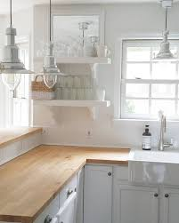 white kitchen decor in farmhouse style and with butcher block countertops