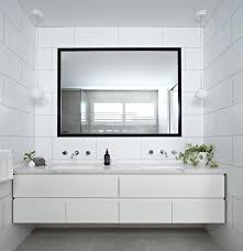 modern white tile bathroom a large black framed mirror stand outs in this white modern bathroom modern white tile bathroom