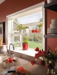 Mini bay window over the kitchen sink with shelving...a