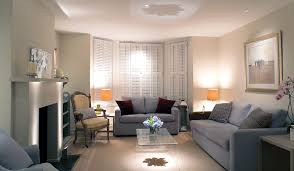 ways to enlarge your living space with light orange appeal best lighting for living room