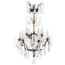 italian four tier brass and bronze crystal chandelier circa 1890