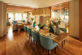 instead of using a round chandelier over a rectangular dining table try using a shape that mimics that of the table