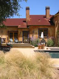 mediterranean outdoor lighting. Patio Furniture And Container Plants Also Lanterns Plus Outdoor Lighting Wood Trim Chimney Stucco Colors For Mediterranean Landscape Design