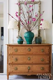 entry chest furniture. The Entry Foyer Mixes Rustic With Formal Touches Thanks To A Textured Mirror And Antique Chest Furniture W