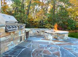 enjoy your outside space surrounded by nature you can grill with guests while relaxing around your fire pit stone broke stack walls and fire pit plus mix