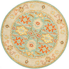 safavieh heritage light blue ivory 9 ft x 9 ft round area rug hg734a 9r the home depot