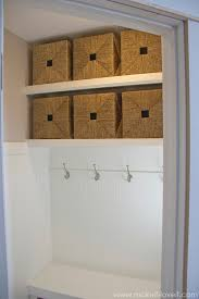 turn a coat closet into a mudroom with hooks and baskets for