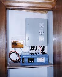 an inverter is installed inside a cupboard on a shelf