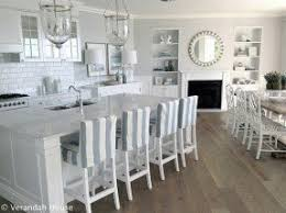 slipcovered counter stools. Beautiful Love The All White Kitchen Pop Of Light Color Accents With Slipcovered Counter Stools