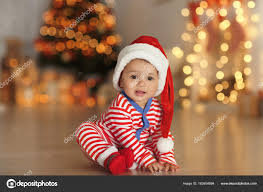 Baby Pics With Christmas Lights Cute Little Baby With Santa Hat On Floor And Blurred