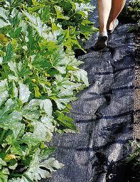 garden mat. Simple Garden Woman Walking On Woven Black Polypropylene Cloth Mat Next To Rows Of  Growing Plants Inside Garden Mat R
