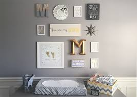If you're looking for gallery wall ideas for nurseries, check out this  lovely display, featuring framed gold footprints and some sweet quotes.
