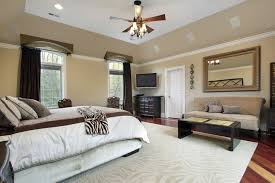 Elegant A Spacious Master Bedroom With A Beautiful Hardwood Floor In Various Light  And Dark Tones.