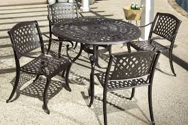 alfresco home westbury 48 round cast aluminum dining set with four stackable dining charis and table