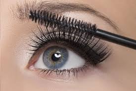 apply two coats of black or blue maa to your lashes