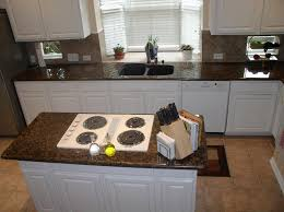 baltic brown with white cabinets and white appliance