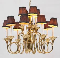 12 light brass chandelier 8 arms 12 lights total on 2 levels no visible makers name 20 h x 27 dia condition shades in need of repair or