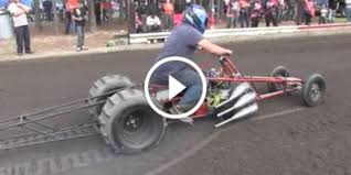incredible bike drag racing in the dirt it is fast and it is loud