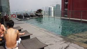 city garden grand hotel. City Garden Grand Hotel: Pool At Top Of Hotel With View