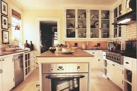 This oven in island kitchen has a wall oven tucked into the end  an usual  oven placement.