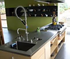stainless steel countertop with sink and custom stainless steel hood above