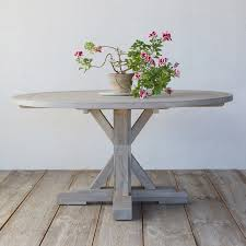 easy pieces round wood outdoor dining tables gardenista round wood patio table with benches round wood