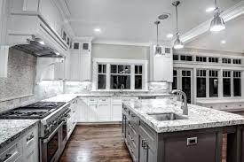 gray granite countertops with white cabinets white kitchen