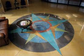 a colorful compass that has been stained into a concrete floor