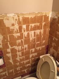 remove gummy material from bathroom