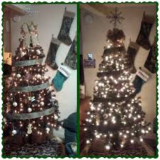 Burlap and camo Christmas tree with Mossy Oak stockings from Cabelas and Browning  ornaments from Etsy