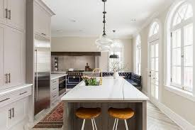 limed oak kitchen units: gray limed oak kitchen island with honed white marble counters