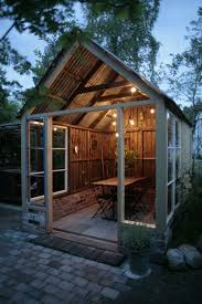 make a backyard party shed like this one with a covered table for eating with guests