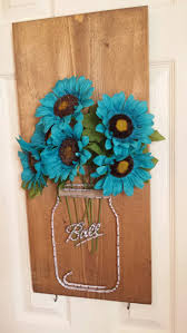 Mason ball jar string art with flowers and hooks. Couryscrafts@gmail.com to