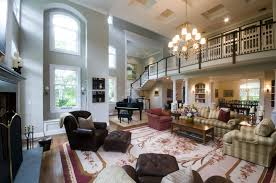 Large Living Room With Two Story Windows Gorgeous Lighting Large Two Story Fireplace