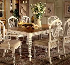 dining room table and white fabric upholstered dark wooden black chairs painted chair with curved back rest