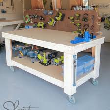 a large workbench on wheels with lower shelf