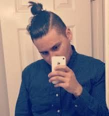 a young body with a cool manbun undercut haircut