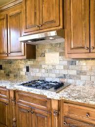 kitchen with oak cabinets ideas light backsplash and white appliances c