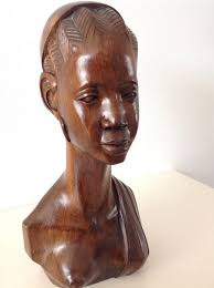 zinga a carved bust of a young african woman iroko wood